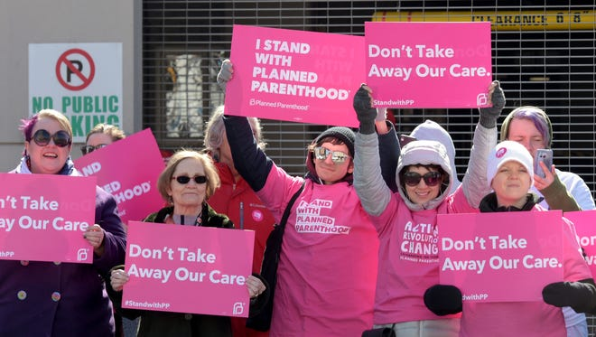 Planned Parenthood members from Nashville protest at Municipal Auditorium before the start of the rally by President Donald Trump Wednesday, March 15, 2017 in Nashville, Tenn.