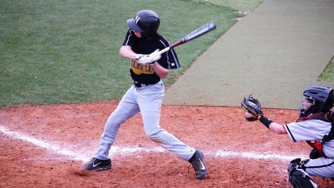 Northwest Rankin's Jacob Chastain swings at a pitch during the summer of 2014, after he had received his leukemia diagnoses but before the cancer damaged his joints.