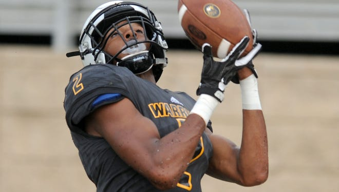 Oak Grove wide receiver Kevin Barnett catches the ball in a game against St. Martin on Friday at Oak Grove High School.