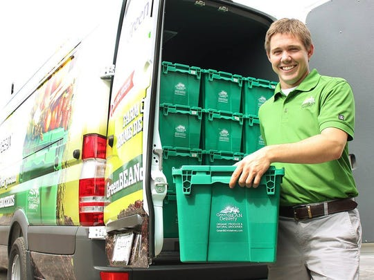 A Green BEAN Delivery associate makes a delivery of fresh, organic produce.