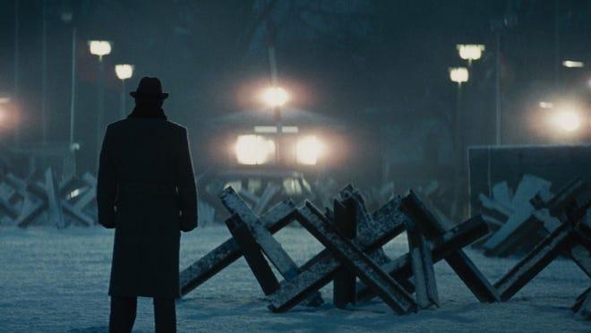 "Tom Hanks waits at the Berlin Wall border crossing in ""Bridge of Spies."""