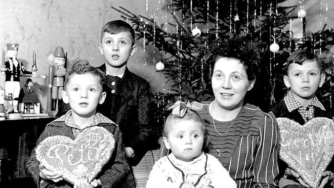 Christmas 1942: Peter, Juergen, Doris, mother, and Gert (now Gerald) Krausse. Note the nutcrackers nearby.