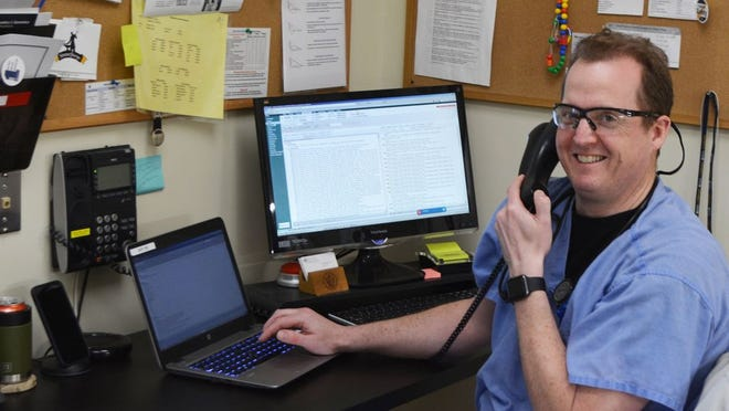Signature Healthcare physician Dr. Paul Pettinato demonstrates a TeleHealth telephone visit.