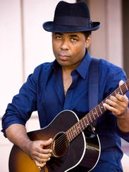 Blues man Chris Thomas King warms up for Word of South