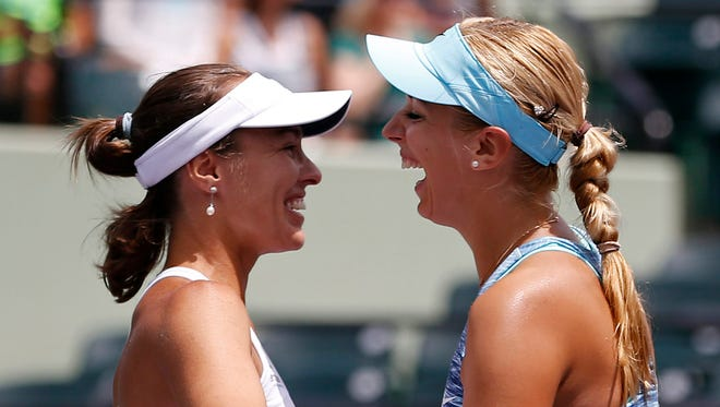 Martina Hingis, left, and Sabine Lisicki celebrate after winning the women's doubles championship of the Sony Open on Sunday.