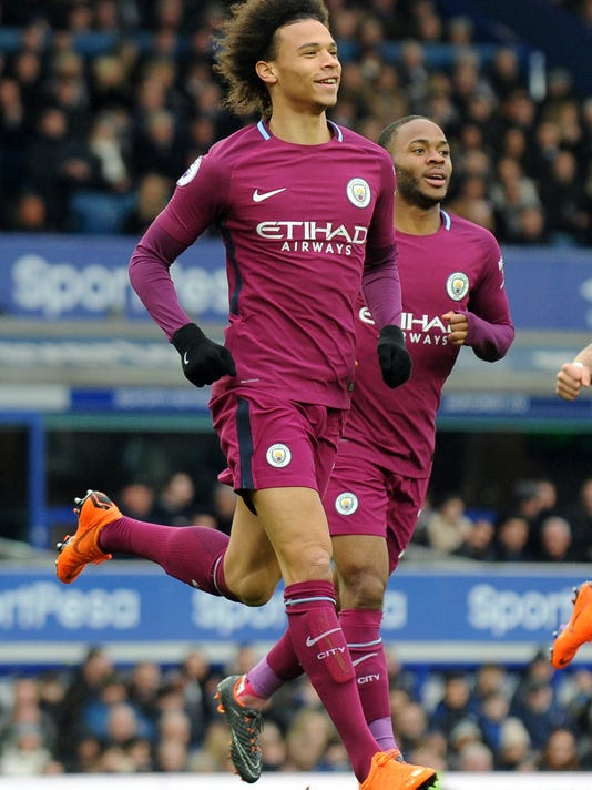 Manchester City's Leroy Sane, left, celebrates with teammate Raheem Sterling after scoring his side's first goal during the English Premier League soccer match between Everton and Manchester City at Goodison Park in Liverpool, England, Saturday, March 31, 2018. (AP Photo/Rui Vieira)