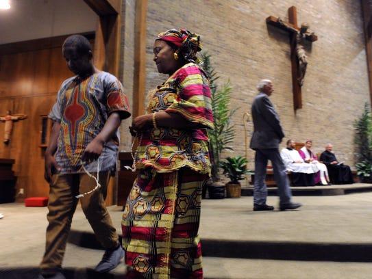 Emile Niyonkuru returns to the pews at Holy Family