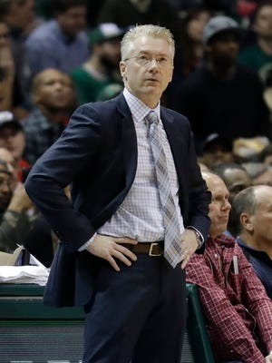 Joe Prunty, filling in for Bucks head coach Jason Kidd, watches during the first half Monday.