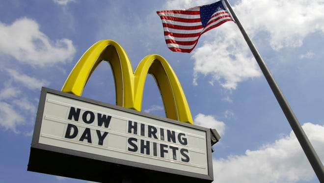 FILE- This May 2, 2012, file photo shows a sign advertising job openings outside a McDonalds restaurant in Chesterland, Ohio. McDonald's on Wednesday, April 1, 2015 said it's raising pay for workers at its company-owned U.S. restaurants, making it the latest employer to sweeten worker incentives in an improving economy.