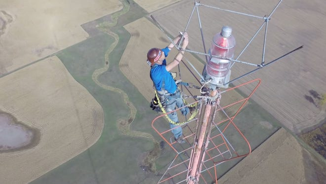 Kevin Schmidt is seen climbing an antenna and taking a selfie in November near Salem. Schmidt sent the picture to his wife, Alla.