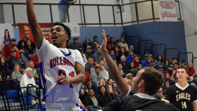 Las Cruces High's Marcus Scott goes up for a one shot against the Hobbs Eagles on Saturday afternoon.