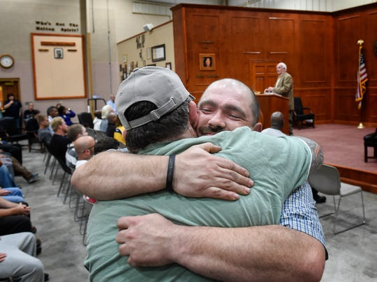 Matthew Lipps is congratulated with a hug from friend Joseph Magrum after he coins out of the drug program at the Davidson County Drug Court on Feb. 28, 2017.