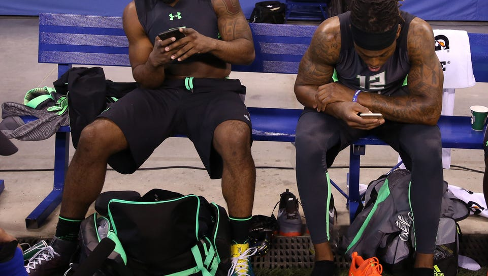 Ezekiel Elliott and Derrick Henry share a bench during