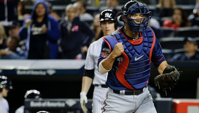 Minnesota Twins catcher Kurt Suzuki pumps his fist after tagging out the Yankees' Brian Roberts at the plate after Roberts tried to score from second base on a single to right field hit by Yangervis Solarte, Friday night.