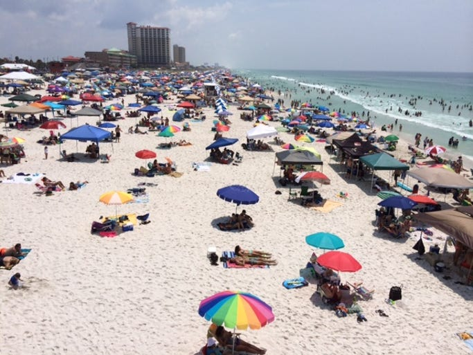 Crowds fill Pensacola Beach ahead of Friday's full-scale dress rehearsal for the Pensacola Beach Blue Angels Air Show.