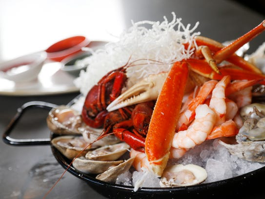 The seafood tower, with snow crab, crawfish, shrimp,
