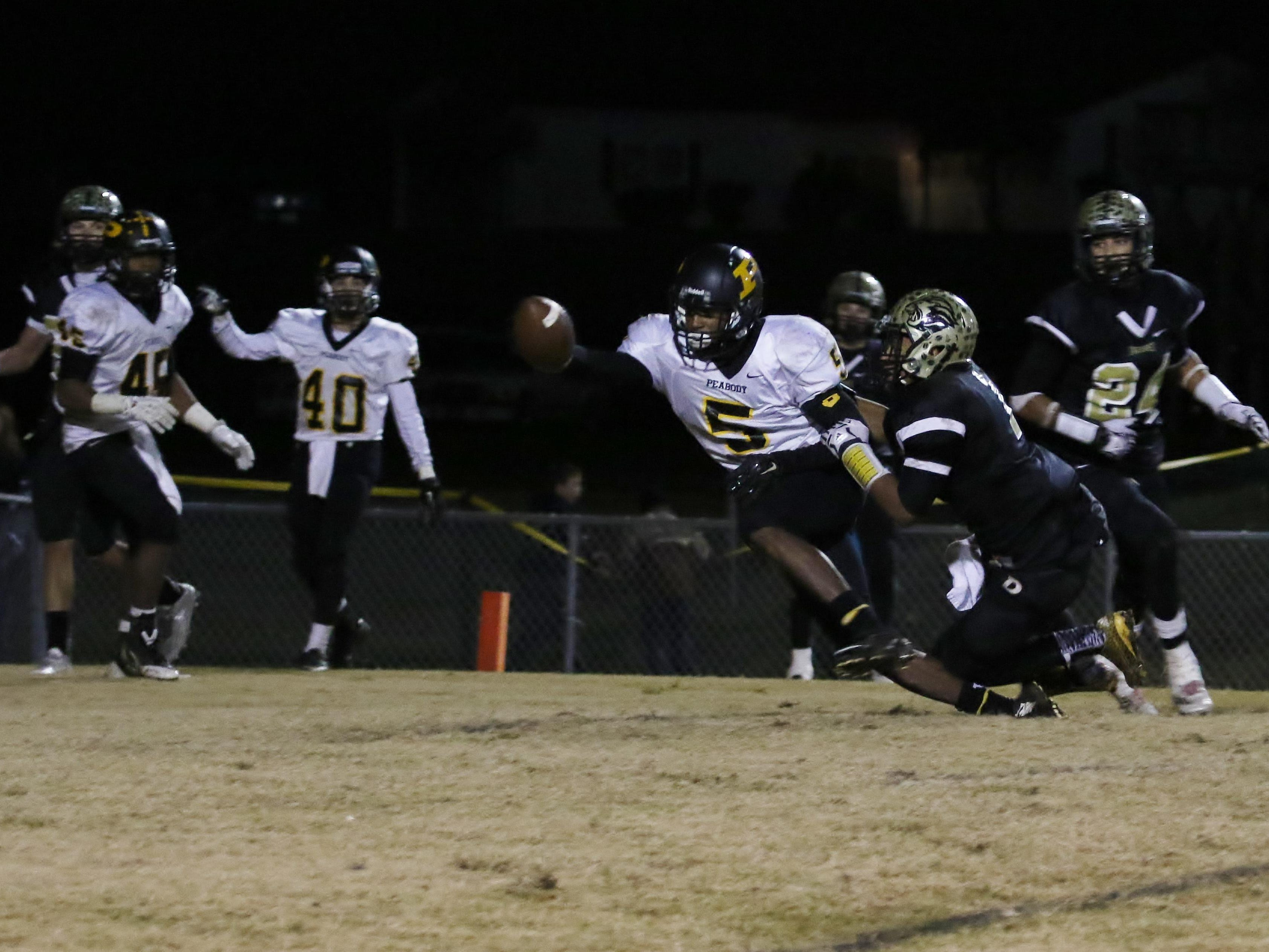 Peabody receiver Keyvon Goodwin tries to pull his way out of a tackle during the second half against Dresden during their Class 1A quarterfinal game last week.