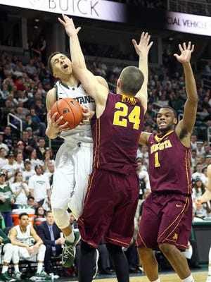Michigan State guard Travis Trice is defended by Minnesota forward Joey King (24) during the 2nd half on Thursday at Breslin Center.