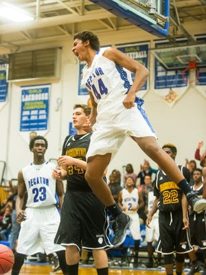 Stephen Decatur forward Keve Aluma (44) goes flexes midair after a dunk against Washington on Thursday, December 17th at Stephen Decatur High School in Berlin.