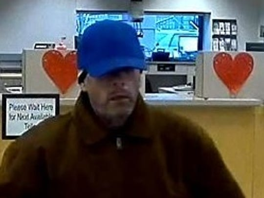 The FBI is searching for a suspected five-time bank robber. Here, he is pictured in a First Federal Saving Bank in Newberg on Friday, Feb. 3.