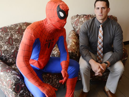 JB Kellogg hangs out with a spiderman statue in the Madwire Media office building on Thursday, June 14, 2012.  Similar statues and wall laminates fill the three story building.