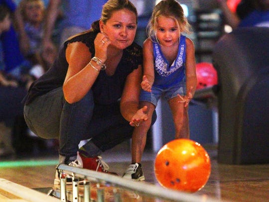Diana Lurie, of Fort Myers, helps her daughter Brooklyn,