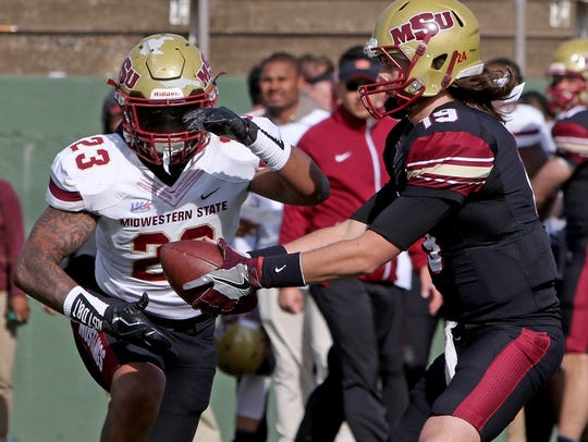 Midwestern State's Triston Williams hands the ball