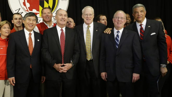 From left in front, University of Maryland President Wallace Loh, Big Ten chief James Delany, University System Chancellor Brit Kirwan, Board of Regents Chairman James Shea and Athletic Director Kevin Anderson announce the big move in 2012.