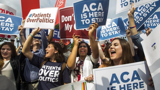 Supporters of the Affordable Care Act cheer after the Supreme Court ruled in favor of the Obamacare tax credits, June 25, 2015.