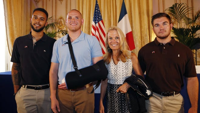 Anthony Sadler, Spencer Stone, Alek Skarlatos and U.S. Ambassador to France Jane Hartley in Paris on Aug. 23, 2015.