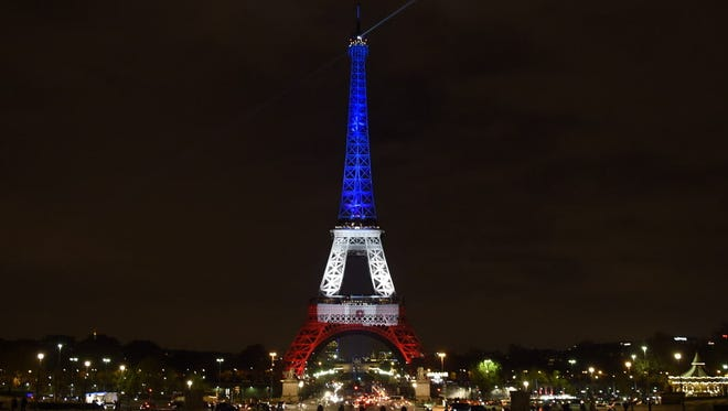 Paris' Eiffel Tower is illuminated Nov. 16, 2015, with the colors of the French flag in tribute to the victims of the Nov. 13, 2015 Paris terrorist attacks.