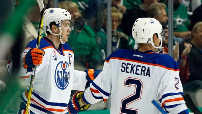 Oilers center Connor McDavid (97) celebrates his hat trick against the Stars.