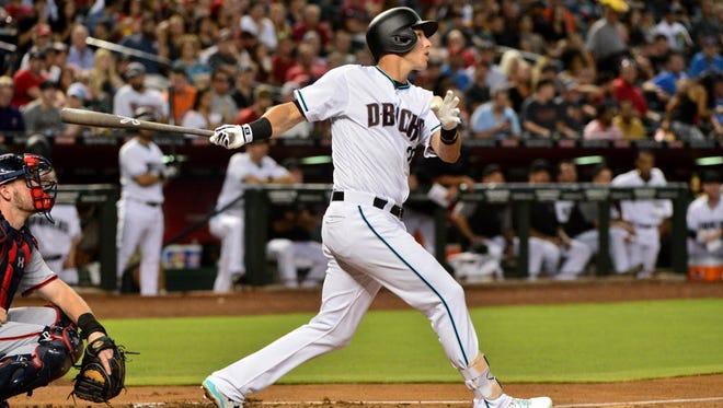 Arizona Diamondbacks third baseman Jake Lamb (22) hits a solo home run in the first inning against the Washington Nationals at Chase Field.