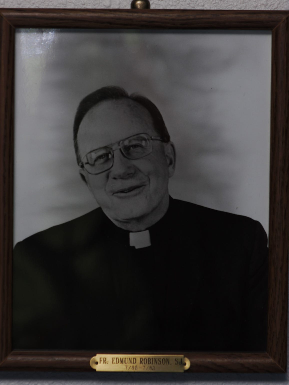Father Edmund Robinson's portrait adorns a basement