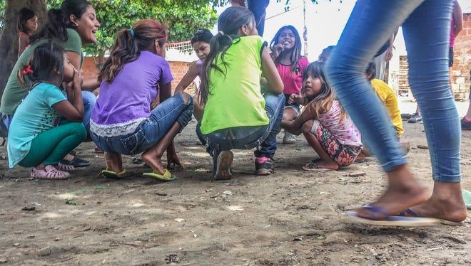 Children play in an Ayoreo village near Santa Cruz de la Sierra, Bolivia.