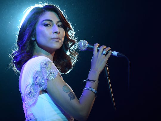 Pakistani actress/singer Meesha Shafi accuses Pakistani entertainer Ali Zafar of sexual harassment.  She performs in this Nov. 17, 2012 file photo.