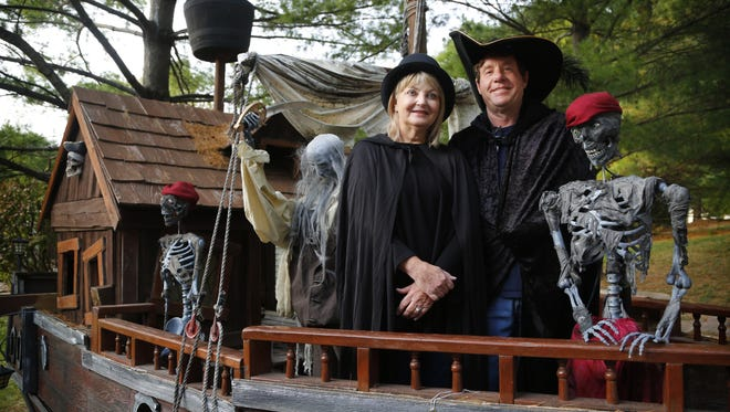 Terrie Kemp and Ed Nelson stand for a portrait at the Zombie Hollow haunted house in Urbandale where the two will be married on Halloween.