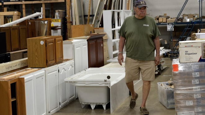 Gene Flathmann looks around Habitat for Humanity Restore Tuesday, May 1, 2018, in Nashville, Tenn. Habitat for Humanity ReStore Deconstruct program allows customers to buy cabinets, bathroom and kitchen fixtures, countertops and other items after being donated by people who redecorated their homes.