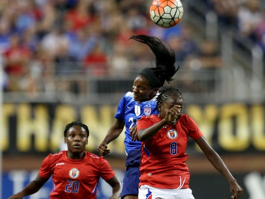 The United States Women's National Team's Chrystal Dunn heads the ball over  Haiti's Sherly Jeudy (8) and Phisline Michel (20  during first half action International Friendly soccer match on Thursday, September17, 2015 at Ford Field in Detroit Michigan.