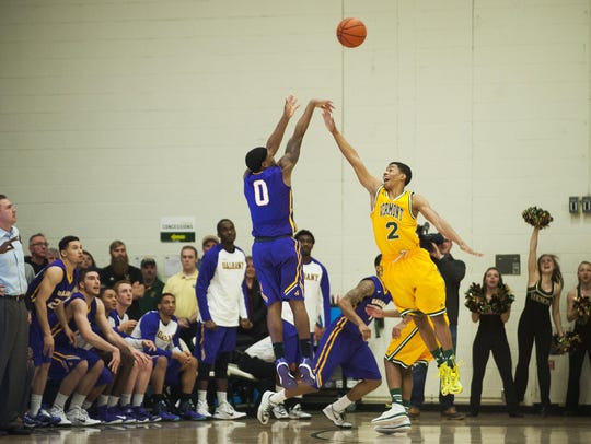Great Danes guard Evan Singletary, left, hits the game-winning