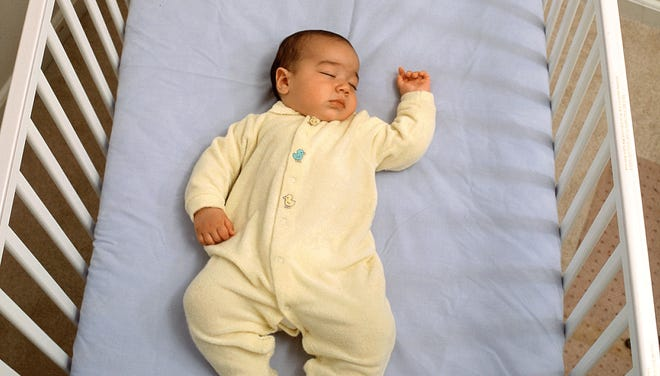 This photo illustrates a safe sleep environment for a baby, in which the risks of Sudden Infant Death Syndrome (SIDS) and other sleep-related causes of infant death are low. Baby is sleeping on its back on a firm sleep surface, and there are no crib bumpers, pillows, blankets, loose bedding or toys in the sleep area.