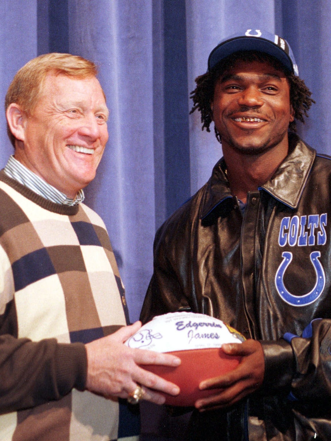 Running back Edgerrin James (right) is presented with