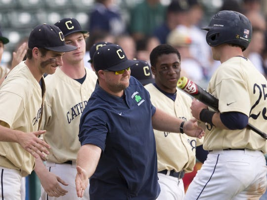 Jared Poland of Cathedral High School, is welcomed home after a five run sixth inning, during the City Baseball Tournament final, Victory Field, Indianapolis, Monday, May 15, 2017. Cathedral High School beat Heritage Christian School, 8-3.