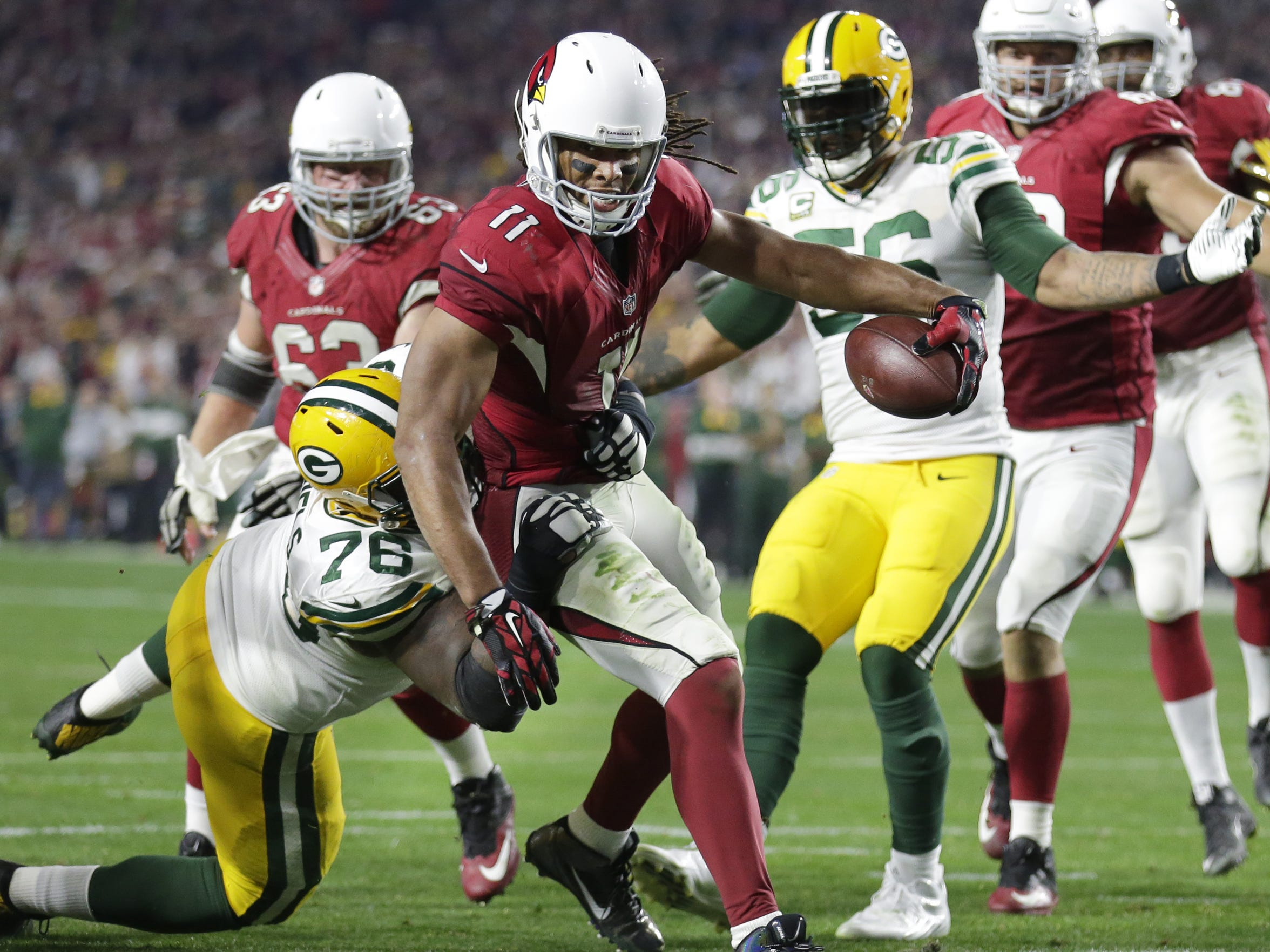 Arizona Cardinals receiver Larry Fitzgerald scores a touchdown in over time to defeat the Packers 26-20.