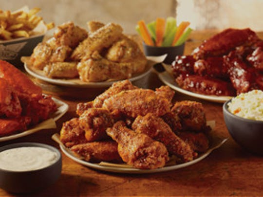 Former Iowa State University quarterback Seneca Wallace plans to open a Wingstop chicken wing restaurant in Ames.
