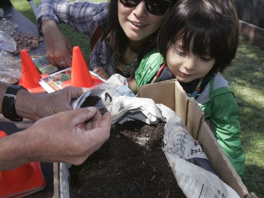Worms get some attention at the Peach Hill Soils booth at a 2014 Earth Day celebration in Oxnard.