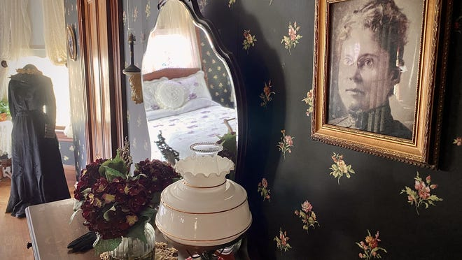 A portrait of a bespectabled Lizzie Borden hangs on the wall of a bedroom inside the Maplecroft house on French Street.