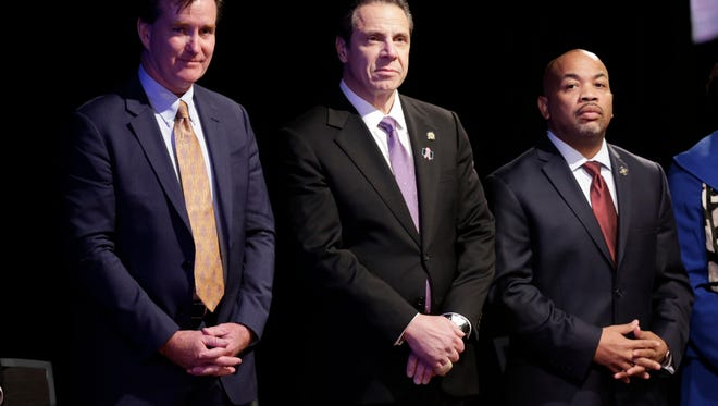 Gov. Andrew Cuomo, center, stands with Senate Majority Leader John Flanagan, left, R-Smithtown, and Assembly Speaker Carl Heastie, D-Bronx, before delivering his State of the State address and executive budget proposal in January.