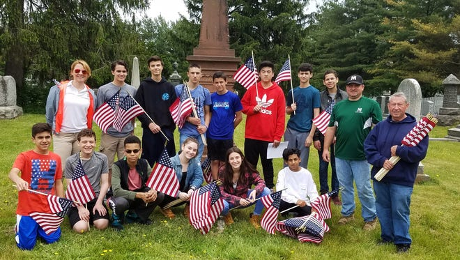 Montville Lazar Middle School students help local Veterans of Foreign Wars place flags on veterans' graves. 