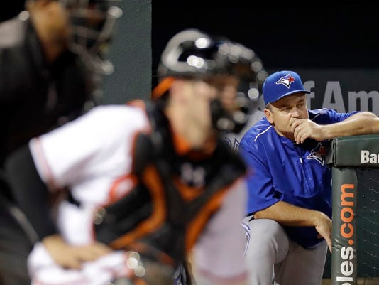 Toronto Blue Jays manager John Gibbons, right, watches from the dugout during the fifth inning of the team's baseball game against the Baltimore Orioles in Baltimore, Wednesday, Aug. 31, 2016. (AP Photo/Patrick Semansky)